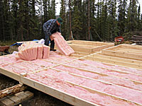 Insulating material is laid into the frame.