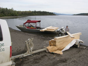 Lumber is transferred onto the boat.